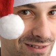 Happy man in a christmas hat — Stock Photo #1627864