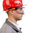 Serious architect in a red hardhat — Stock Photo #1627983