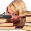Young woman between books — Stock Photo