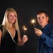 Young couple with Bengal fire — Stock Photo #1628641