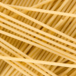 Uncooked italian spaghetti background — Stock Photo