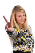 Young lady showing victory sign — Stock Photo