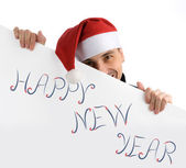 Happy man in a christmas hat — Stock Photo