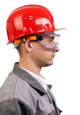Serious architect in a red hardhat — Stock Photo