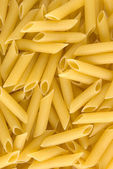 Uncooked pastas background — Stock Photo