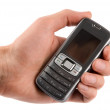 Mobile phone in man hand — Stock Photo