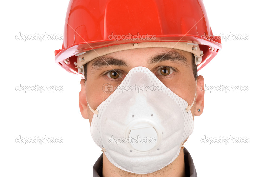Man in a mask and a red safety helmet — Stock Photo #1630525