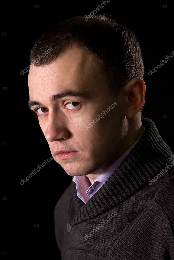 Portrait of the sad man thinking in the dark  Stock Photo #1637700