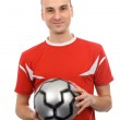 Young man holding a soccer ball — Stock Photo #2034953