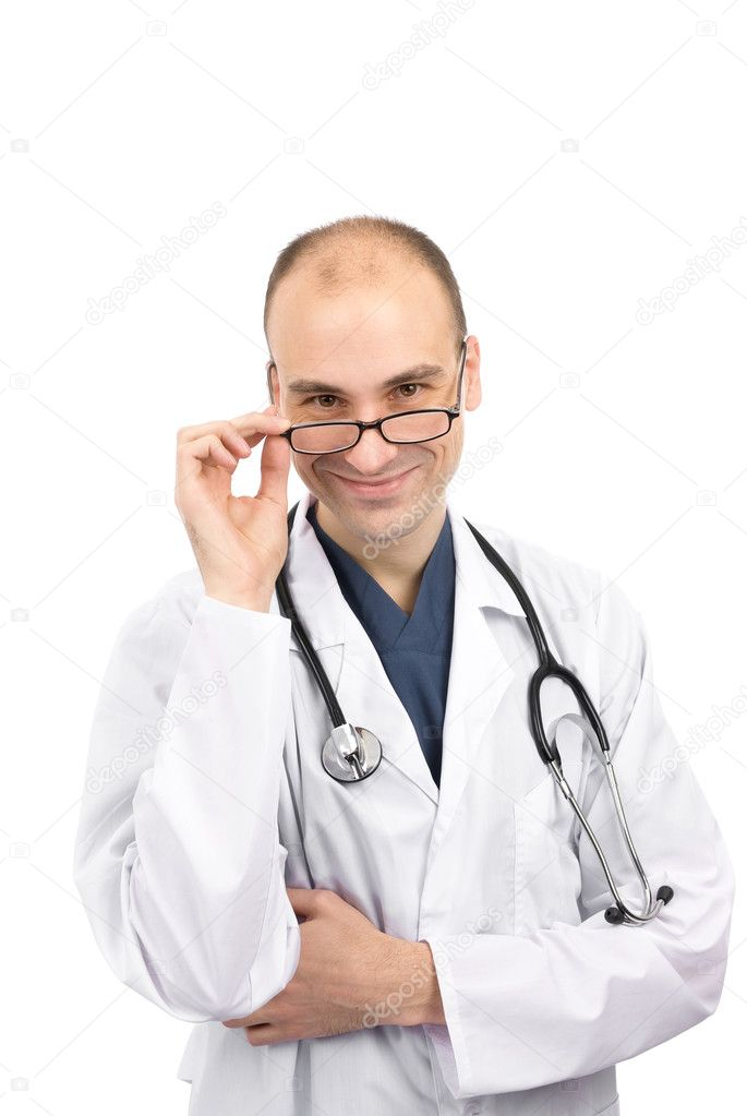 Male doctor smiling isolated over a white background  Stock Photo #2034846