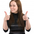 Young lady showing thumb's up sign — Stock Photo