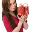 Happy girl with gift box - Stock Photo