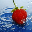 Royalty-Free Stock Photo: The Strawberries in drop.