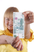 The girl and the monetary denomination — Stock Photo