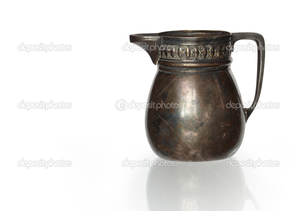 Ancient bronze jug isolated on white background with clipping path — Stock Photo #1084793