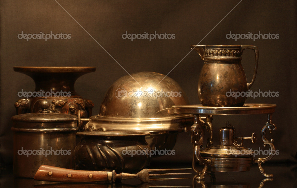 Collection of various bronze vintage dishware on brown background — Stock Photo #1084855