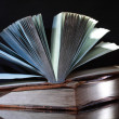 Stock Photo: Old books on dark