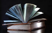 Old books on dark — Stock Photo