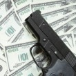 Gun and money — Stock Photo