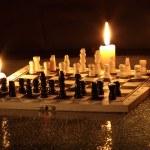 Шахматы и свеча — Стоковое фото