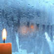Candle On The Window - Stock Photo