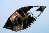 Old rusty boat in water after shipwreck — Stock Photo