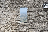 Window in the wall of the castle — Stock Photo