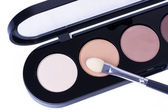Make-up applicator on eye shadows — Stock Photo