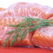 Royalty-Free Stock Photo: Salmon on red cutting board