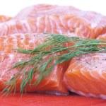 Salmon on red cutting board — Stock Photo #1059073