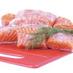 Salmon on plastic cutting board — Stock Photo #1059099