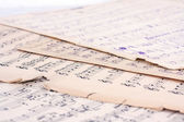 Music notes on old pieces of paper — Stock Photo