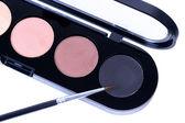 Makeup brush on eye shadows — Stock Photo