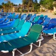 Many chaise-longues on the beach — Stock Photo