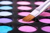 Pink eyeshadows with brush — Stock Photo