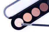 Make-up applicator on palette — Stock Photo