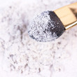 Stock Photo: White broken eyeshadows with applicator