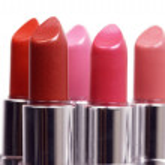 Five red lipsticks — Stock Photo