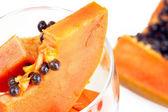 Slice of papaya in glass — Stock Photo