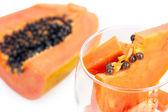 Closed-up glass with papaya — Stock Photo