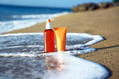 Tubes with sun protection in waves — Stock Photo