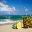 Pina colada on beach of ocean — Stock fotografie