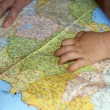 Child's hand on map — Stock Photo #1354422