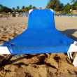 Stock Photo: Chaise-longue on beach