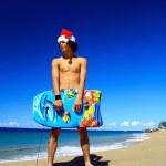 Caribbean Santa with surf — Stock Photo