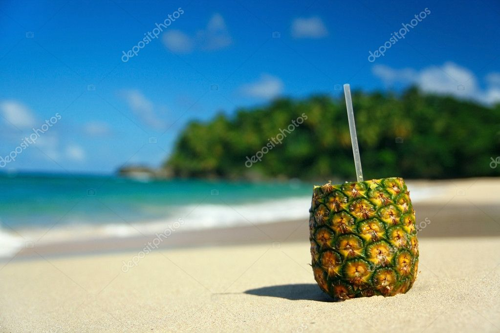 Pinacolada with pipe on beach of Atlantic ocean — Stock Photo #1617576