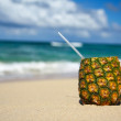 Pinacolada with pipe on beach — Stock fotografie