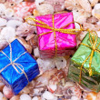 Present boxes on seashell — Stock Photo #2118672