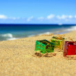 Surprise presents on a beach - Stock Photo