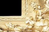 Golden frame on black — Stock Photo